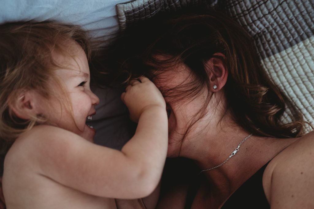 Best Maternity and Newborn Photographer Washington DC mother and toddler girl daughter cuddling and playing